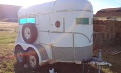 Two horse horse-trailer in good condition. Newer tiers, good floor boards and mats, removable divider, tack compartment, brakes and lights work, higher than average roof height.