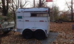 2 horse bumper pull trailer. New tires, pulls good. The black u see on top is tree sap, I couldn't. Reach it to clean Senatobia 662-560-3130 1000.00 Obo