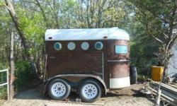 older 2 horse trailer in good condition . good floor, walls not rusted at bottom, new tires and white spoke rims, front storage asking $1500