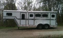 3 Horse GN for sale. Weekender with cabinets, fridge, microwave (not pictured...out for cleaning), walk through door to horse area. Escape door in first stall, stud divider, two roof vents per stall, vented tack room, SWING OUT SIDE TACK (can back