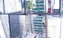 This is a beautiful Avian Accents Oak Bird Cage This is a large, furniture like bird cage. Approximately 34 inches wide, 69 inches tall, and 27 inches deep. Needs new lock, has plexiglass insert to keep things cleaner. Some chew marks and minor wear