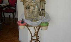 Sell a Beautiful 4 Parakeet with vintage cage. Parakeet are colored green, blue and purple. Pickup only. For more information, please call (646) 669-4809.