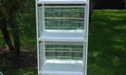 Features:?Shelf stand ?Heavy duty caster ?Holds 4 cages White Color/Finish:?Powered coated finish NO Assembly required Dimensions:?Dimensions: 59'' H x 26'' W x 16.5'' D
