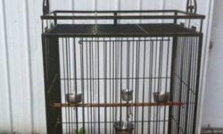 have a large bird cage with a breeding box and tree stand and other toys this cage could be used for macaws to parrots and all other birds also have a mobile stand for the birds. will seperate or sell together asking 350.00 This ad was posted with the