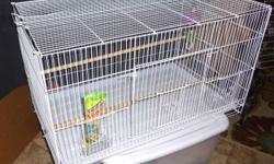 """Bird Cage, large, like new, comes with package of """"Honey Sticks,"""" toy, perches and dishes. Nice big cage, too many birds, outgrew it. Width: 31 inches Height: 18 inches Depth: 18 inches 623-873-5215 please, no text to land line."""