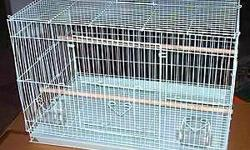 New white cage, never used, comes with perches and dishes. This cage is a newer model and made stronger than the older ones. It has four doors in front making it very easy to keep clean and a pull out cleaning drawer. It will house anything from Finch