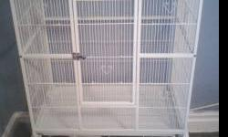 brand new parrot cage! comes with built in playtop area and 4 stainless steel food and water bowls plus seed guards!