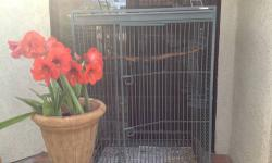 """HUGE CALIFORNIA CAGE FOR SALE. $200 MUST BRING TRUCK, THIS CAGE IS VERY HEAVY AND WELL BUILT. 5 """"8 TALL WITH PLAY PEN 40"""" WIDE 30"""" DEEP 3 safety feed doors One good sized door Play pin on top On rollers Located in San Diego 619 240-4443"""