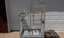 "Extra large bird cage in excellent condition Come with 4 stainless steel bowls & 2 wood perches Size is 48"" wide 28"" deep & 6 ft tall"