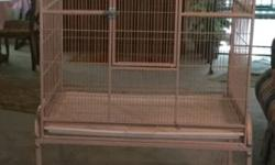 """2 Flight cages for sale $140. Ea. One Sand and the other green cage. Will easily hold two or three birds from Cockatiel, to blue Crown Conure size. Two part cage plus fitting stand on wheels. Size of cages: H 2' 11"""", D 1' 91/2"""", W 2' 81/2"""" total H with"""