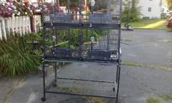 Multi unit quad cage by A&E bird cages for sale. The cage can be divided into two, three, or four units, and has doors that pop out to accommodate nest boxes. Large cage great for breeding birds, maybe a conure or parrot, or maybe a rat cage or other