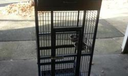 """Really nice cage for any medium-size bird. It measures 18"""" x 18"""". It is 50"""" high to the top of the cage alone and 61"""" high to the top of the play-top perch. Wrought iron cage in Black Hammertone color. 4 Stainless steel cup holders, cage stand, playtop"""