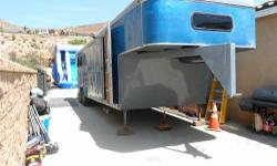 1989 Competitive 3 horse slant with Live in quarters. Has bran new tires and rims, new brakes, and is in good condition. This trailer is heavy duty. Weighs 12,000 Lbs. This trailer has a sink, bathroom with shower, bed, small couches, cupboards and more.