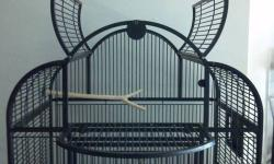 """I HAVE A LARGE BIRD CAGE FOR SALE.. VERY NICE CAGE EASY TO MOVE AROUND HAS CASTERS AND ALSO EASY CAGE TO CLEAN, DARK GREEN IN COLOR NO RUST OR DAMAGE. THE PICTURE IS JUST LIKE THE ONE I HAVE. DEMINSIONS ARE: 30"""" WIDE 56"""" HIGH TOTAL 18"""" DEEP 36"""" HIGH"""