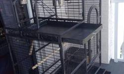 Large use bird cage in good conditions. Very spacious dark gray color cage. play stand on the side. Two doors, One in front second one on the side. approximately size 5'6 high 57 width, 4 stainless steel containers two inside two outside. removable seed