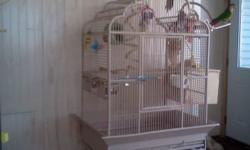 Cream colored bird cage. Top opens up with a perch. In excellent shape, no rust. Original cost was $250. Please email or text. Ph 651-270-2830