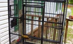 """Large heavy duty bird/parrot cage 32"""" long x 24"""" wide x 59"""" tall Has 4 swing out feeder doors. Has door for nest box. Great for an african grey, cockatoo, amazon, conure, etc. $125 912-677-9565"""