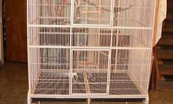 Very clean and powder coated large parrot cage with playtop with cups! Also on castors! no trades or shipping please.