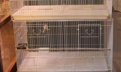 30 x 18 x 18 white breeder cages with side door for nest box. 3 for $100. Like new, less than 4 months old. There are 9 available. Can purchase cages with shelves, nest box, lighting and cage extras. 3 unit system is $175. Each 3 unit system cost over