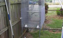 Hey i have a large flight cage for parrots. $40.00 fair to good shape. needs a good cleaning.
