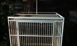 Parrot Cage with stand in good condition. It has a play top where your parrot can hang out. The bar spacing are 1in. Great for medium to large size parrots, like conures, african greys, amazons, cockatoos, macaws, etc. It measures 25in L x 35 W x 54 H.
