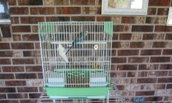 """Just reduced Again! We have a HEALTHY year old blue male parakeet. He is somewhat tame although he has not been hand-tamed yet. He is very active and curious. Cage is 13 1/2"""" (L) x 11"""" (W) x 16"""" (H) Does NOT come with stand - used for taking picture only."""