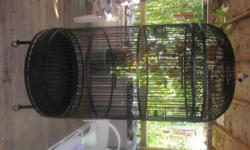 """Beautiful extra large black wrought iron vintage parrot cage. Excellent condition. Cage does not break down. Measurements 35"""" diameter, 6ft 3""""high"""