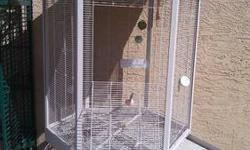 The green cage is for mediun parrot. To macaw..the white cage can be use for finches to conures ...text or email me 6025755317...skin 150 each