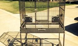 We have some parrot cages that have been slightly used. The black is 100.00, the green is 200, and the beige one is 300.00. The beige has a slider divider to have two cages in one if you want or two separate areas