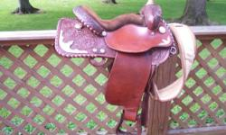 Silver Royal saddle. Gold and Silver accented. 15-15 1/2 inch seat. Saddle is smooth and tooled. Great for 4-H showing. Good condition. $550 or OBO, no trades.