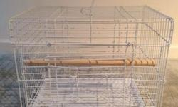 Large Bird Travel Carrier Cage in new condition-16.25 inches wide by 12 inches deep by 13.75 inches high. Very thick, strong bars. Pull out tray for easy cleaning. Thick perch included. Color: White. Large front door with locking latch bars. Can be used