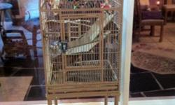 """Used Tan cage very clean, 16"""" deep x 18"""" wide x 30"""" high, with stand 56"""" high, comes with skirt, Orlando area pick up only, 407-857-4342. This is a land line no text please"""