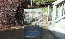 Wire cage in good condition suitable for breeding birds or whatever. Has bottom tray for cleaning, opening for nesting box, and opening for feed bowls.If interested call (530) 268-2086 I do not respond to e-mails.Located in Grass Valley.